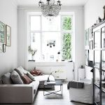Small Living Room, Wooden Floor, White Wall, Glass Cabinet, Grey Corner Sofa, White Chair, Black Coffee Table, Chandelier