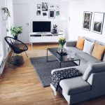 Small Living Room, Wooden Floor, White Wall, Grey Corner Sofa, Black Coffee Table ,white Cabinet, Black Rattan Chair
