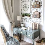 Small Study, Rug Floor, White Wall, Green Wooden Classic Table, Floating Accessories On The Wall, White Table Lamp