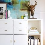 White Cabinet With Drawers And Shelves, Wooden Floor, White Walll, Painting