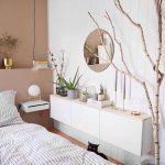 White Floating Cabinet, White Wall, Round Mirror, Bed
