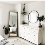 White Wooden Cabinet With Round Handler, White Floor, Mirrors, White Wall