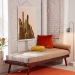 Wooden Bench, Grey Cushion, Red Yellow Pillows, Grey Floor, Orange Rug, White Exposed Wall