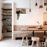 Wooden Bench, Wooden Table, Wooden Stools, White Wall, Indented Wall, Indented Shelves Wooden Board, Black Pendants