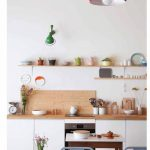 Wooden Floating Shelves, White Cabinet, Wooden Counter Top, Wooden Backsplash, Red Pendant, Green Sconce