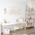 Wooden Floor, White Wall, White Table With Curvy Legs, Golden Chair, White Wall, Crystal Chandelier, Golden Shelves