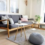 Wooden Sofa, Grey Cushion, Wooden Floor, White Round Side Table, Grey Rug, Grey Ottoman