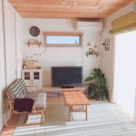 Wooden Sofa With Grey Cushion, Wooden Coffee Table, Wooden Plank Ceiling, White Wall, Wooden TV Cabinet
