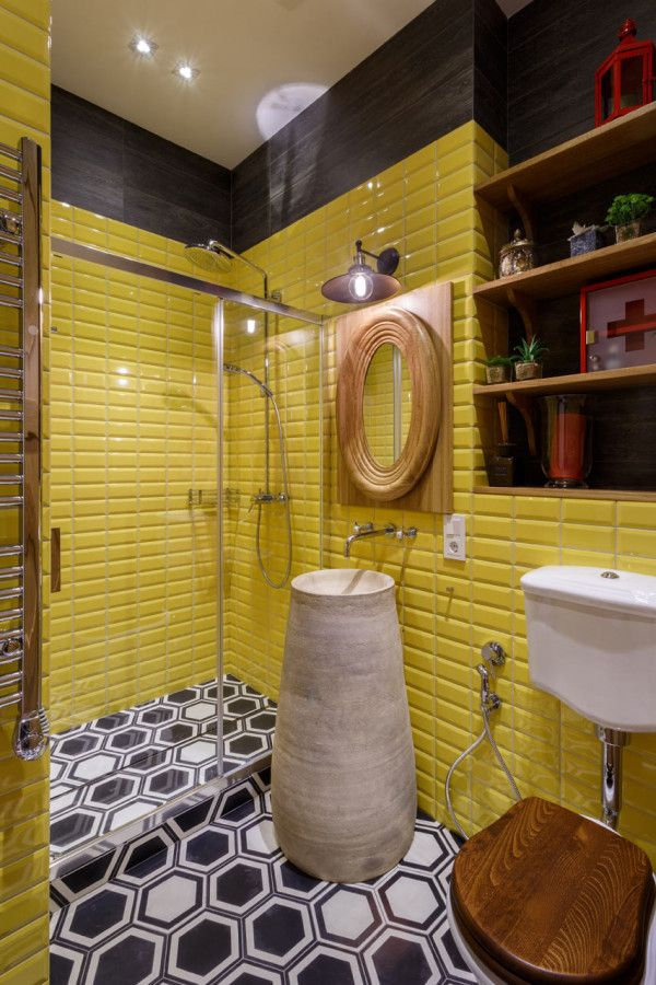yellow bathroom, patterned hexagonal floor, toilet with wooden lid, yellow subway wall, indented shelves, sink