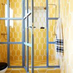 Yellow Bathroom, Yellow Hexagonal Ties On The Wall And Floor, Blue Framed Glass Partition, Toilet
