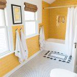 Yellow Bathroom, Yellow Subway Tiles On The Wall, White Wall, White Tiny Floor Tiles, White Tub, White Curtain, White Toilet