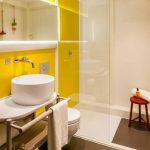 Yellow Bathroom, Yellow Wall, White Wall, White Sink, White Vanity, White Toilet, Brown Floor