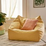 Yellow Bean Bag, Brown Rug Floor, White Patterned Rug, Pink Pillows