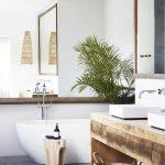 Bathroom, Grey Floor Tiles, White Wall, White Tub, Wooden Vanity Table, White Sink, Large Mirror