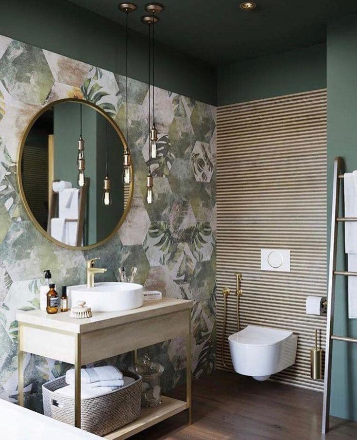bathroom vanity, green leaves wallpaper, round mirror with golden frame, wooden vanity table, white sink