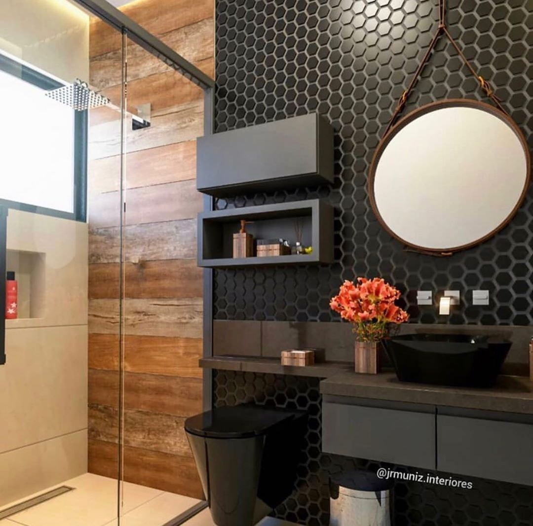 bathroom vanity, wooden wall, black backsplash, black floatig vanity, black toilet, black indented shelves, round mirror