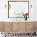 Bathroom, White Wal, Wooden Cabinet, Mirror, White Top, Sconces With Glass And White Accent Inside