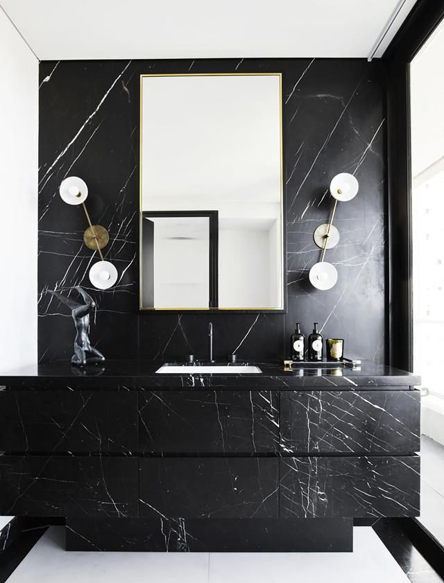 bathroom, white wall, black marble wall, black marble cabinet, black marble top, black marble accent wall, unique sconce, mirror