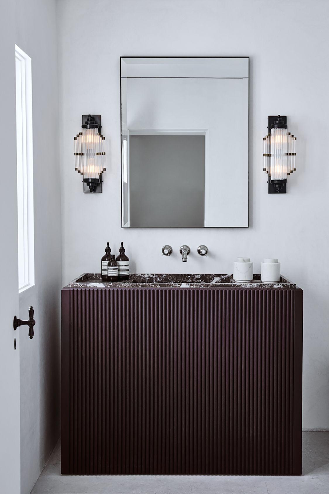 bathroom, white wall, sconces, black grid cabinet vanity