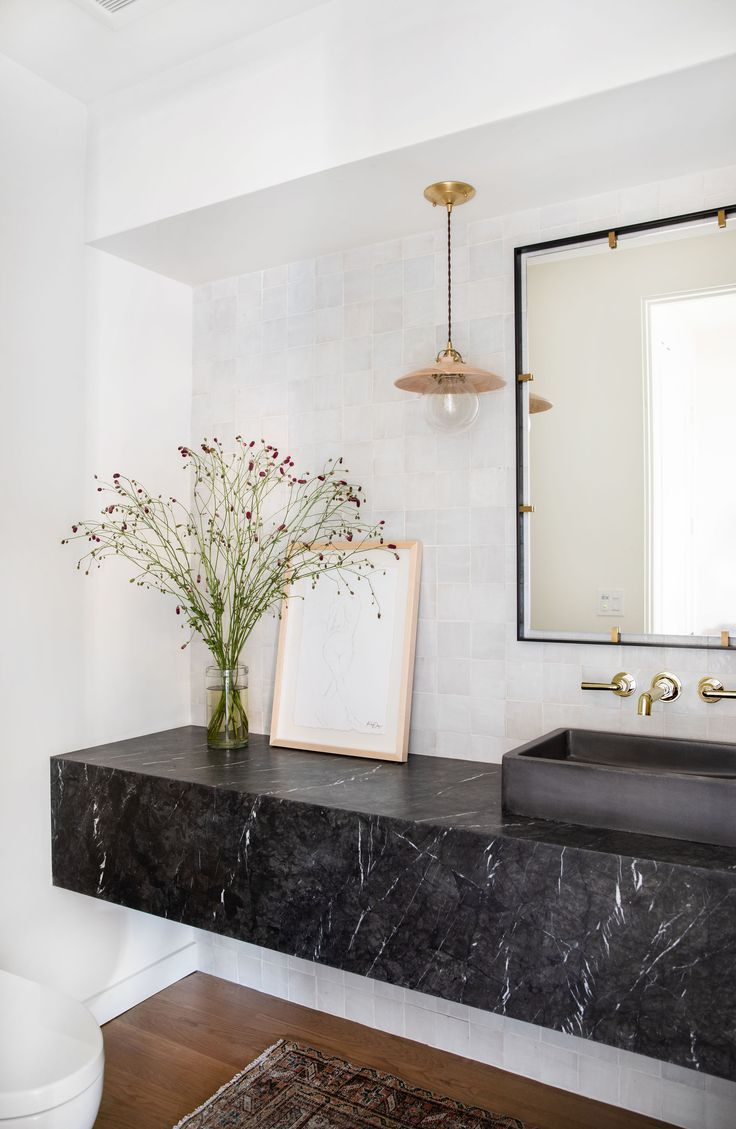 bathroom, white wall, white wall tiles, black marble floating vanity, black sink, pendant, square mirror