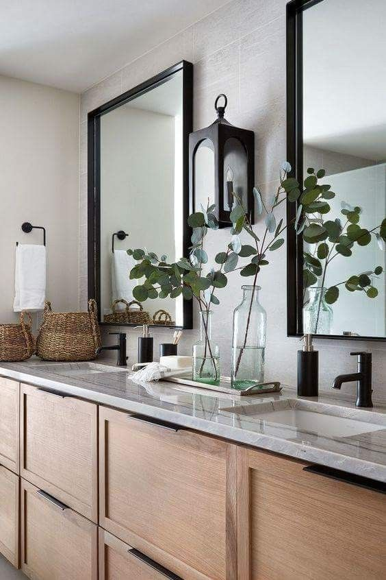 bathroom, wooden vanity cabinet, grey wall, grey top, mirrors, black iron traditional sconce, mirror