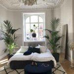 Bedroom, Wooden Floor, Patterned Rug, Blue Velvet Round Ottoman, Blue Velvet Bed Platform, White Wall, White Carved Accent Ceiling, Chandelier