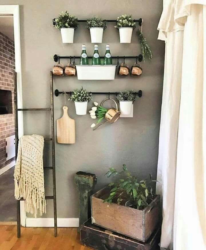 black iron hanging rods, black iron hooks, grey wall