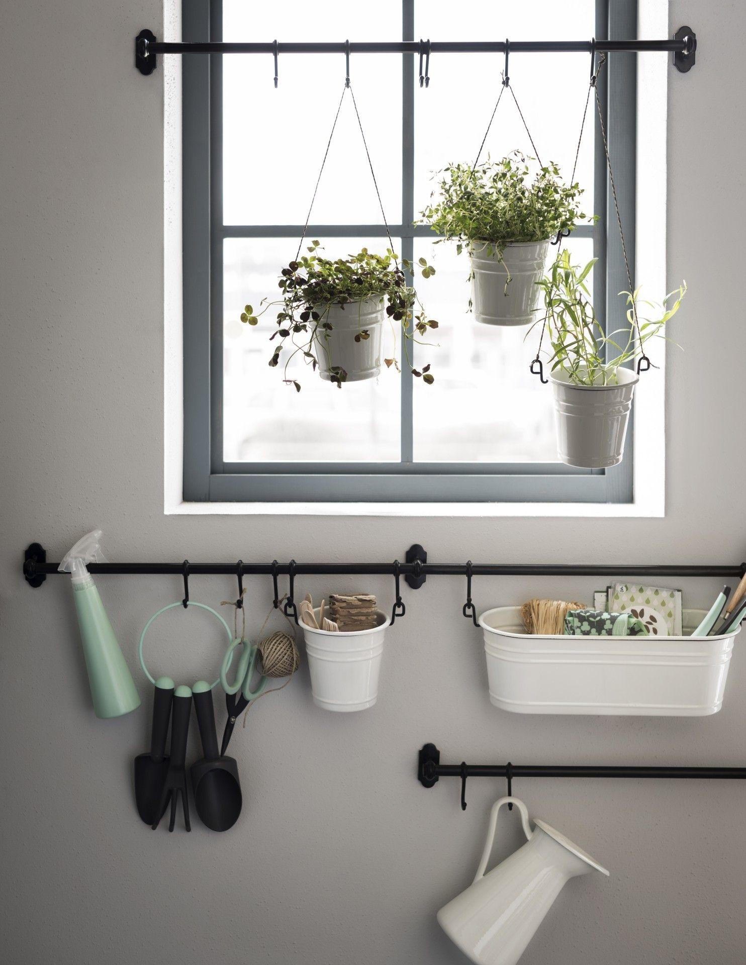 black iron hanging rods, black iron hooks, white box and storage