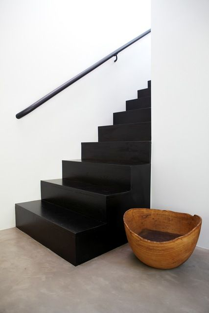 black stairs, white wall