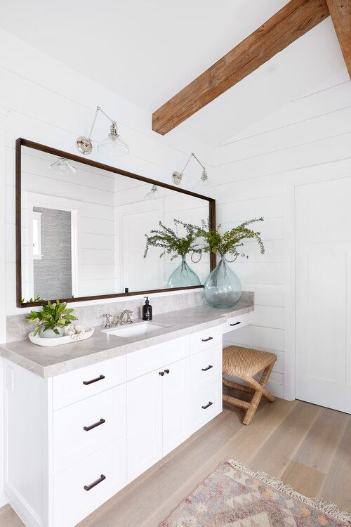 clear pendants with stick, white wall, white cabinet, wooden floor