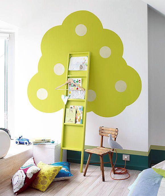 corner, white, green painted tree, green display shelves, wooden floor