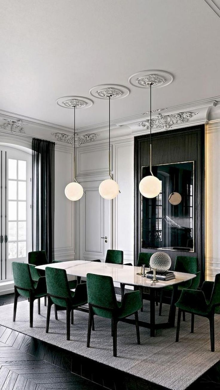 dining room, dark chevron floor tiles, grey rug, white marble dining top, green chairs, globe pendants