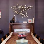 Dining Room, Purple Wall, Wooden Framed Fireplace, Chandelier, Wooden Table, Wooden Chairs With Black Cushion