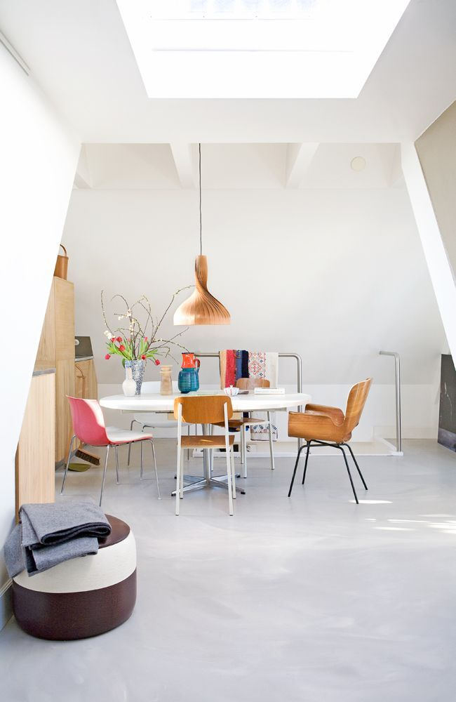 dining room, seamless floor, white wall, white round table, wooden chairs, pink chair, wooden pendant, wooden cabinet