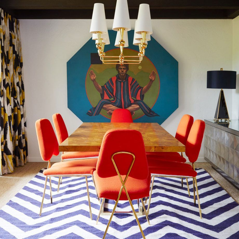 dining room, white blue striped zigzag, white wall, patterned curtain, white chandelier, brown dining table, orange chairs, grey cabinet, black table lamp