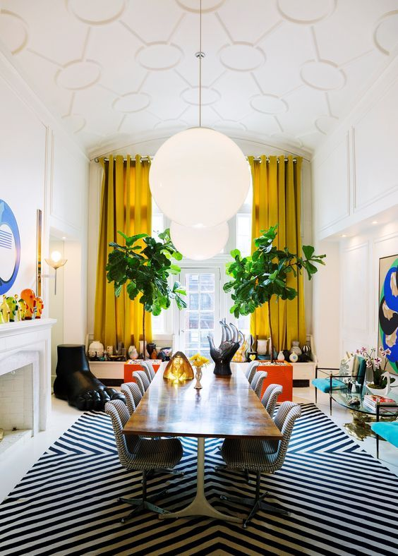 dining room, white floor, white black rug, rectangular wooden table, white table, yellow curtain, white pendants, blue chairs, round glass table