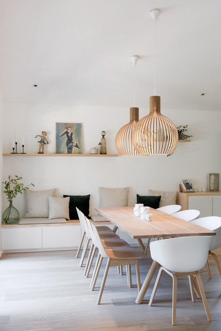 dining room, white wooden floor, white wall, white built in bench, wooden rectangular dining table, rattan pendants, white wooden modern chairs