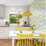 Dining Room, Wooden Floor, White Subway Wall, White Wooden Ceiling, White Yellow Wallpaper, Yellow Pendant, White Wooden Table, Yellow Wooden Chairs