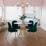 Dining Room, Wooden Floor, White Wainscoting, Pink Wall, White Pendant, Round Glass Table With Golden Legs, Green Chairs With Golden Legs