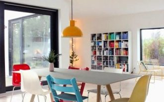 dining room, wooden floor, white wall, white bookshelves, wooden dining table, modern chairs, orange pendant, big glass window