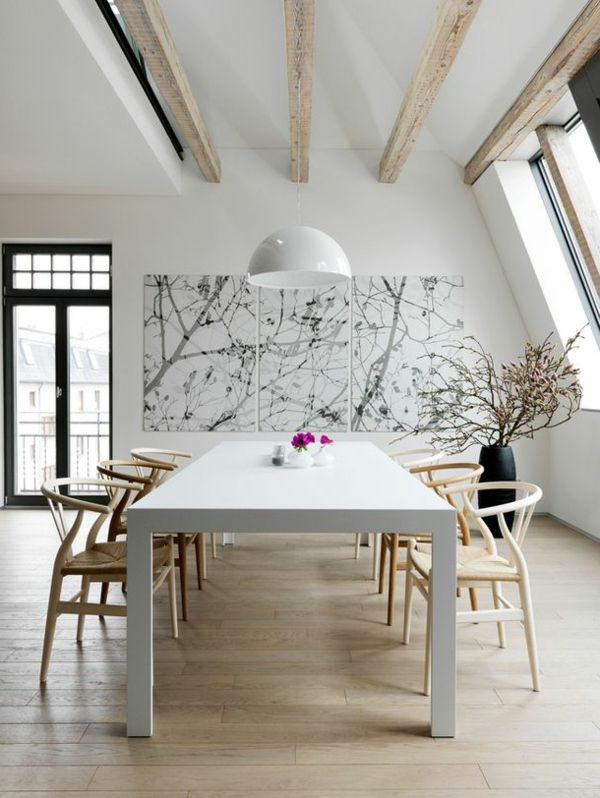 dining room, wooden floor, white wall, wooden beams, white table, wooden chairs rattan seat, white pendants, black pot,