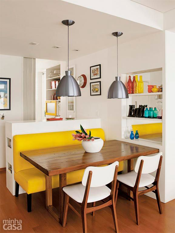 dining room, wooden floor, white wall, wooden dining table, white dining chairs, yellow bench, silver pendants