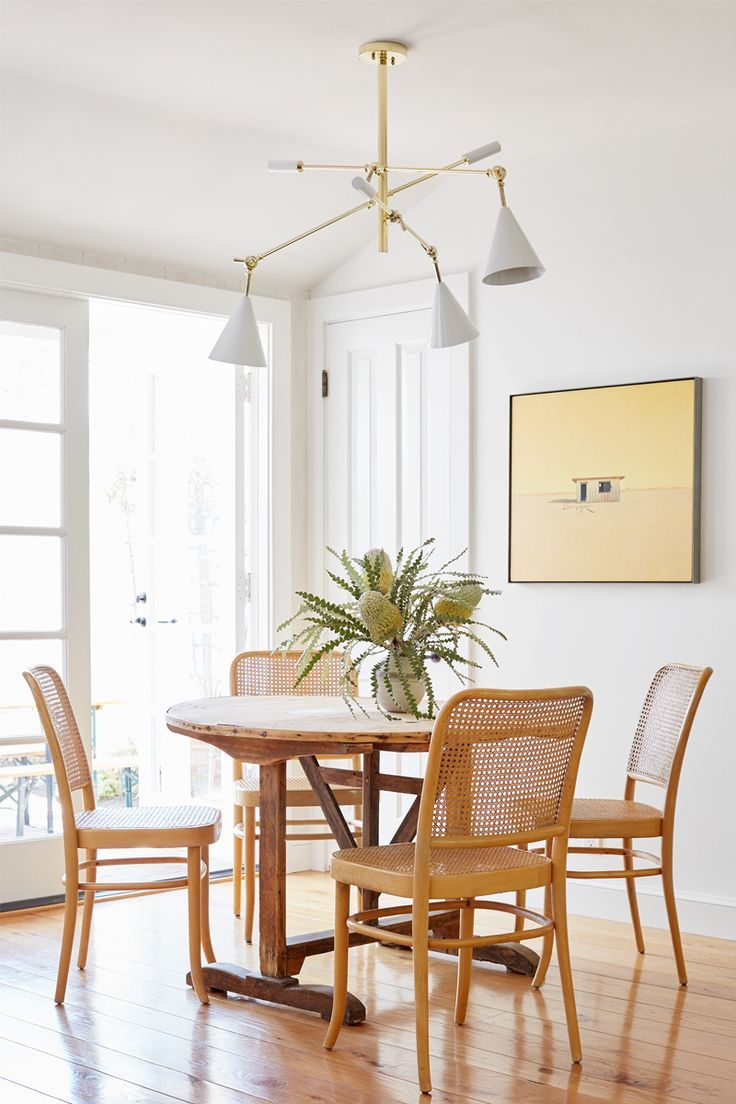 dining set, wooden floor, white wall, wooden chairs, wooden round table, white pendants
