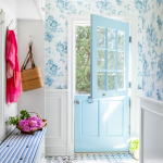 Entrance, Blue Door, Half Top With Glass, White Wainscoting, Blue Flowery Wallpaper, Blue Patterned Floor, Blue Bench