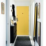 Entrance, White Floor, Whitewall, Yellow Door, Black Floating Cabinet