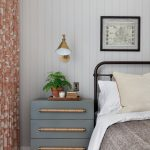 Greyish Blue Cabinet With Three Tiers Drawers, Wooden Door Knob, Golden Sconce, White Wall