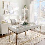 Home Office, Wooden Floor, Brown Rug, White Table With Golden Legs, White Cabinet, White Shelves, White Floating Shelves, Grey Chair
