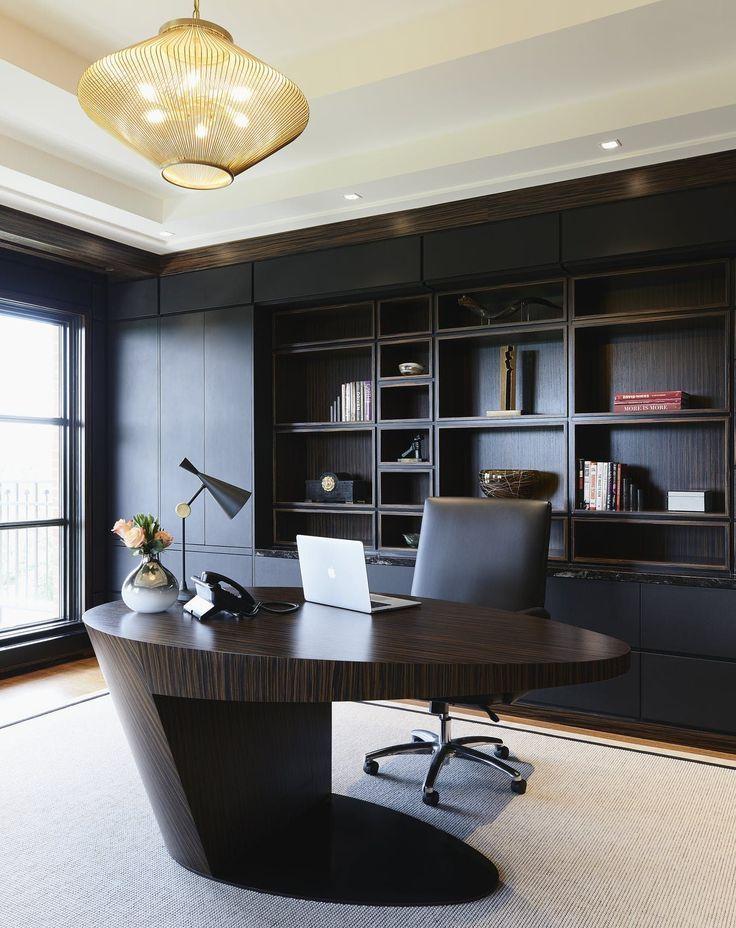 home office, wooden floor, white rug, black built in shelves, wooden table, black office chair, golden pendants