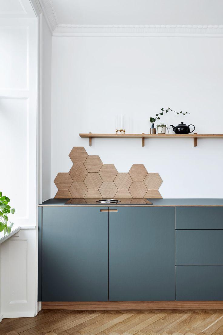 kitchen, blue kitchen cabinet, white wall, wooden hexagonal accessories, wooden floating shelves