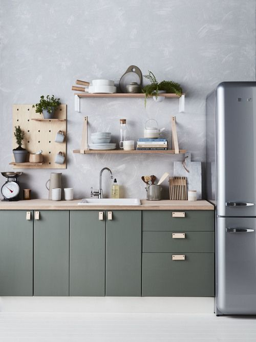 kitchen, white floor, grey wall, green kitchen cabinet with wooden top, wooden floating shelves, grey freeze